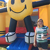 Carol Harper - The Morning Journal <br> Anna Cacchione volunteered to oversee eight large bouncy activities for children June 24-26, 2016, at Lorain International Festival at Black River Landing in Lorain.
