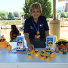 Carol Harper - The Morning Journal <br> Geri Pastor offers ducks for adoption June 25, 2016, at Lorain International Festival at Black River Landing. The fundraiser, Adopt-a-Duck, raises money for Lorain International Association and for Boys and Girls Clubs of Lorain County. Adopted ducks race 3 p.m. June 26 down the Black River.