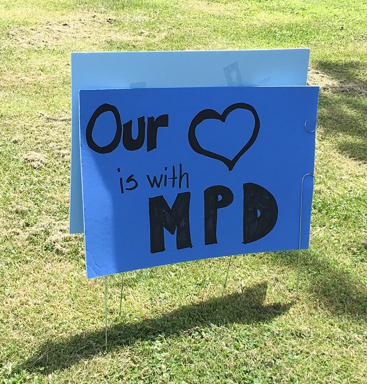 . A sign in a front yard on Center Street in Mentor honors Ptl. Mat Mazany. (Bill DeBus - The News-Herald)