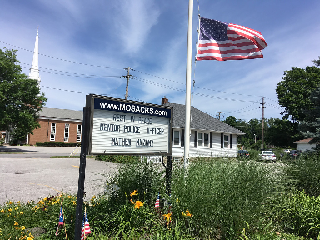 . Mosack\'s Religious Goods and Supplies on Mentor Avenue pays tribute to Ptl. Mat Mazany. (Bill DeBus - The News-Herald)