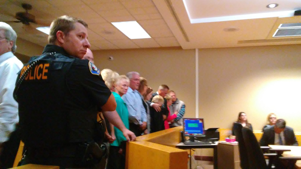 . The family of suspect Brian A. Anthony stands in Mentor Municipal Court on June 25. (Betsy Scott - The News-Herald