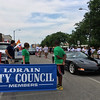 Carol Harper - The Morning Journal <br> Lining up for the Lorain International Festival Parade on Broadway Avenue in Lorain includes groups and sleek cars.