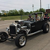 Carol Harper - The Morning Journal <br> Unusual vehicles attracted parade viewers this year.