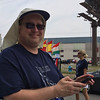 Carol Harper - The Morning Journal <br> Timothy Sivik, director of Lorain High School Titans Marching Band, prepares for the start of a 50th Anniversary Lorain International Festival Parade June 26, 2016, on Broadway Avenue in Lorain.