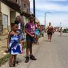 Carol Harper - The Morning Journal <br> Ahmoni, 4, and Laniyah Johnson, 6, watch for princesses June 26, 2016, at Lorain International Festival Parade on Broadway Avenue in Lorain.