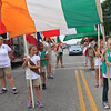 Carol Harper - The Morning Journal <br> Girl Scouts from around Northeastern Ohio wait with flags before the 50th Anniversary Lorain International Festival Parade began June 26, 2016, on Broadway Avenue in Lorain.