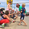 Carol Harper - The Morning Journal <br> Children scramble for candy June 26, 2016, at Lorain International Festival Parade on Broadway Ave. in Lorain.