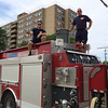 Carol Harper - The Morning Journal <br> Lorain Fire Chief Tom Brown, right, and firefighter Chris Conrad wait with water for a 50th Anniversary Lorain International Festival Parade to start June 26, 2016, on Broadway Avenue in Lorain.