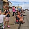 Carol Harper - The Morning Journal <br> Odin Napier, 2, and Lyla Napier, 7, Lorain, watch the Lorain International Festival Parade June 26, 2016, on Broadway Avenue in Lorain.