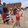 Carol Harper - The Morning Journal <br> Heather Marshall, 23, left, Elyria, watches a Lorain International Festival Parade with Javid West, 8, and Zariah West, 3, who are children of her friend Cynthia West, 28, Elyria, not pictured, and Marshall's twins Jaida and Jaiden Marshall, both three years old. The children gathered a pile of candy to share June 26, 2016, on Broadway Avenue in Lorain.