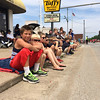 Carol Harper - The Morning Journal <br> Cousins Sean Grudier, 11, Zachary Grudier, 6, Gabrielle Grudier, all Lagrange, Dane Bednarik, 8, Lorain, and Donovan Grudier, 8, Lagrange, sat on a blanket on a curb to watch Lorain International Festival Parade June 26, 2016, with their grandmother, Paula Belch, 58, Lorain, (not pictured). The favorite attraction was the princesses, followed by the cars and the bands, Belch said.