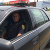 Carol Harper - The Morning Journal <br> Robert Hargreaves, investigator with the traffic division at Lorain Police Department, brings a 50th Anniversary Lorain International Festival Parade to a close June 26, 2016, on Broadway Avenue in Lorain.