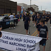 Carol Harper - The Morning Journal <br> Lorain High School Titans Marching Band prepare for the march June 26, 2016, in a Lorain International Festival Parade.