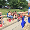 Carol Harper - The Morning Journal <br> A Clearview High School athlete passes out treats at Lorain International Festival Parade June 26, 2016, in Lorain.