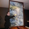 Janet Podolak -- JPodolak@News-Herald.com<br /> Michael Reaves, assistant general manager at the new Hyatt Place Hotel at Legacy Village, shows off a large 1890 map of Lyndhurst, complete with names of property owners. It's a focal point in the new hotel's lobby.
