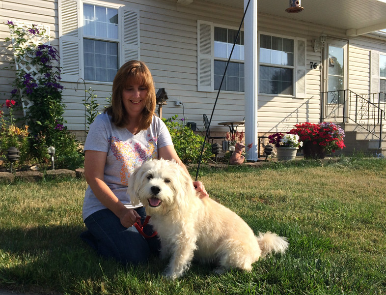 Carol Harper - The Morning Journal <br> Susan Chutes, 76 Caesars Circle, Amherst, was awakened about 3:30 a.m. July 1 by her four-year-old, terrier-poodle mixed dog, Jack. Normally a calm, quiet dog that trains for agility competitions, Jack was pacing back and forth in the living room, growling and barking loudly. When Chutes looked outside, her neighbor's front deck and a wall of their modular home was engulfed in flames at 80 Caesars Circle. The Drew Woodings family, a girl spending the night, their dog and a bearded dragon escaped uninjured, Amherst assistant fire chief Jim Wilhelm said. Wilhelm estimated the damage at $170,000 in structure and contents. No cause was determined, he said.