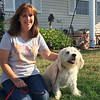 Carol Harper - The Morning Journal <br> Susan Chutes credits her dog, Jack, a terrier-poodle mix who himself was a rescue puppy, with waking her up when their neighbors' modular home caught fire about 3:30 a.m. July 1, 2016, at 80 Caesars Circle, Amherst. The family escaped uninjured.