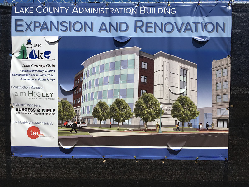 A rendering of the new Lake County administration building is hanging at the construction site in Downtown Painesville. The new building will centralize some of the county's currently scattered departments.  (Andrew Cass - The News-Herald)