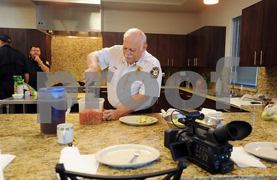 copyright 2012 Sarah A. Miller/Tyler Morning Telegraph  Assistant Fire Chief David Schlottach prepares a pico de gallo salad at Tyler Fire Station 5 Friday during the taping of a cooking segment for television station Channel 3.