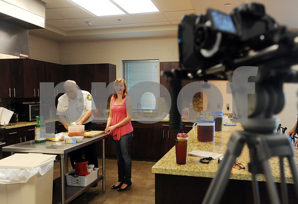copyright 2012 Sarah A. Miller/Tyler Morning Telegraph  Assistant Fire Chief David Schlottach prepares a Mexican goulash and pico de gallo salad for a television segment with Channel 3 host Serena Butcher at Tyler Fire Station 5 Friday.