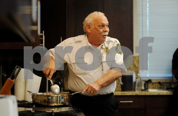 copyright 2012 Sarah A. Miller/Tyler Morning Telegraph  Assistant Fire Chief David Schlottach cooks a Mexican goulash at Tyler Firestation 5 Friday during the taping of a segment for television station Channel 3.