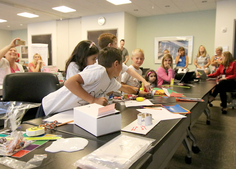 Jonathan Tressler - The News-Herald. the elementary school contingent of a, Avery Dennison/Partners in Science Excellence team-building and S.T.E.M. education collaboration get excited about science Aug. 9 at Avery Dennison's facility on Norton Parkway in Mentor.