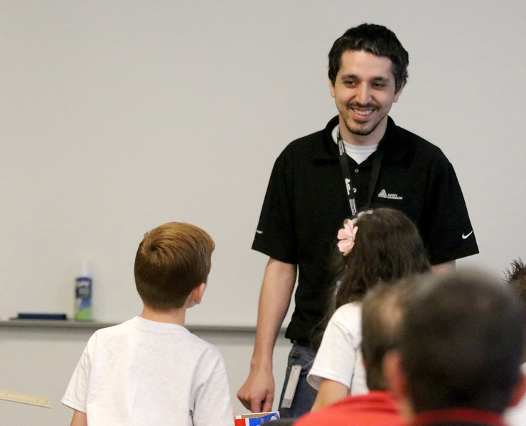 Jonathan Tressler - The News-Herald. Edward Khodaei, quality engineering technologist with Avery Dennison, interacts with two of the elementary school students involved in a S.T.E.M. education team-building collaboration involving the company and Partners in Science Excellence Aug. 9.