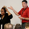 "Jonathan Tressler - The news-Herald. Avery Dennison employees, from left, Lateefah Hafeez, quality control technical specialist, and Shane Bendelewski, application consultant make their ""Shark Tank""-like presentation during a team-building collaboration involving the company and Partners in Science Excellence Aug. 9."