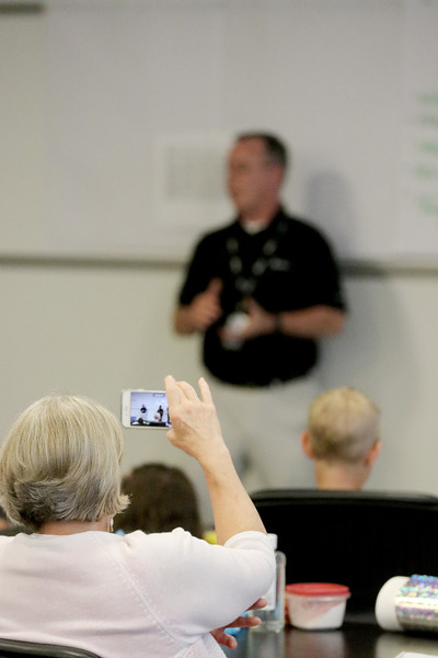 Jonathan Tressler - The news-Herald. a participant in the Avery Dennison/Partners in Science Excellence team-building and S.T.E.M. education collaboration uses her mobile phone to capture video of one of the presentations.
