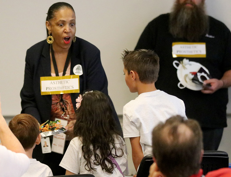 Jonathan Tressler - The news-Herald. Ophelia Gallagher, an Avery Dennison application consultant, contributes to her team's S.T.E.M. learning kit presentation Aug. 9 at the company's facility on Norton Parkway in Mentor.