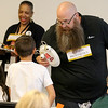 Jonathan Tressler - The News-Herald. Keith Gliesman, a regional technical manager with Avery Dennison, explains some of the application for eth company's many adhesive products to a group of elementary school testers Aug. 9 during a collaborative team-building exercise between the company and Partners in Science Excellence.