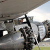 Jonathan Tressler - The News-Herald. Two of the three engines and a happy passenger on the Ford Tri-Motor aircraft visiting Lost Nation Airport through Aug. 12.