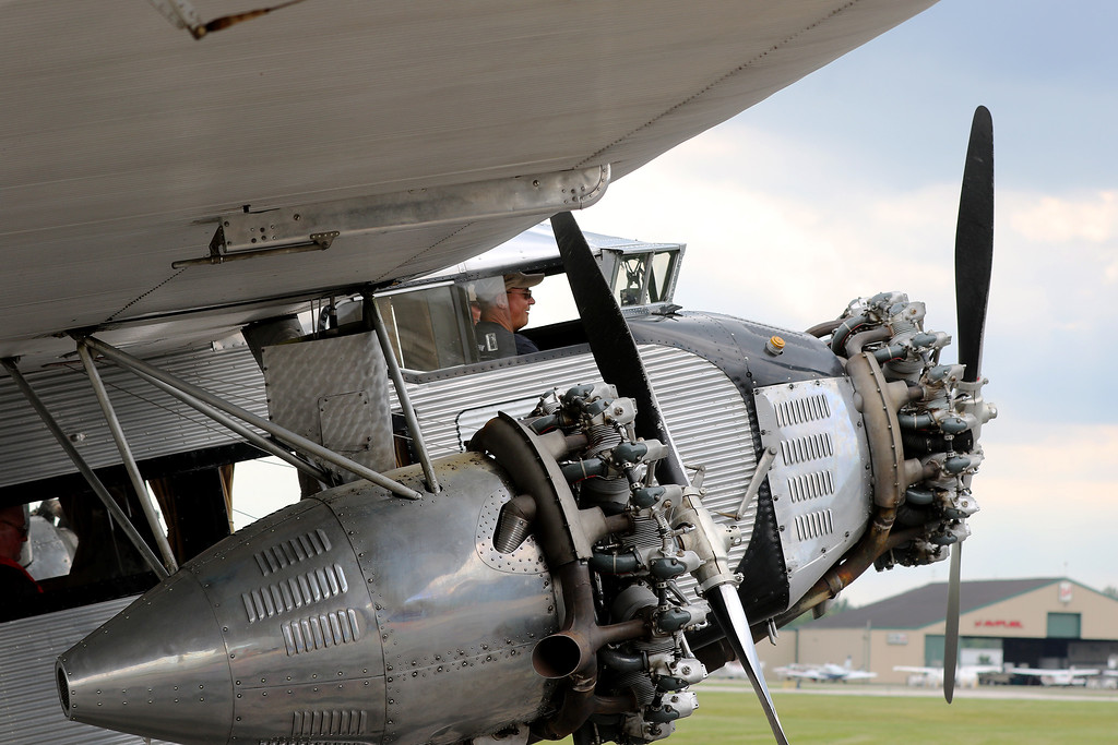 . Jonathan Tressler - The News-Herald. Two of the three engines and a happy passenger on the Ford Tri-Motor aircraft visiting Lost Nation Airport through Aug. 12.