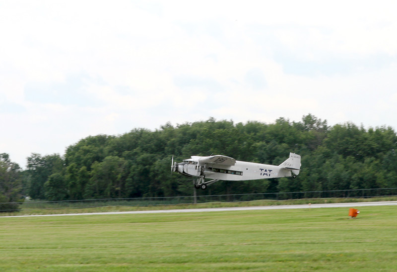 Jonathan Tressler - The News-Herald. The Ford Tri-Motor aircraft visiting Lost Nation Airport through Aug. 12 just leaving the ground on takeoff.