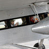 Jonathan Tressler - The News-Herald. Some happy passengers aboard the Ford Tri-Motor aircraft visiting Lost Nation Airport through Aug. 12 strriking one of the more popular poses while seated inside - the cell-phone snap.