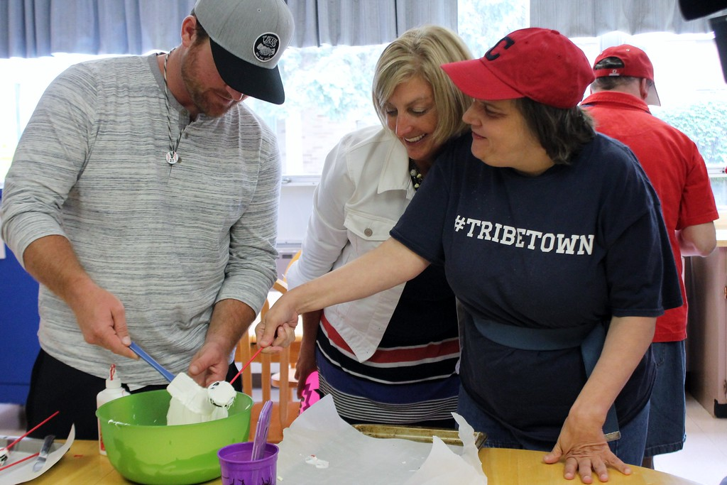 . Kristi Garabrandt � The News-Herald <br> Lake County Captains manager, Larry Day helps Wendy Robinson make a an Oreo cookie into a baseball themed desert while Denice Winter looks on  during the Captains community service day at Broadmoor.
