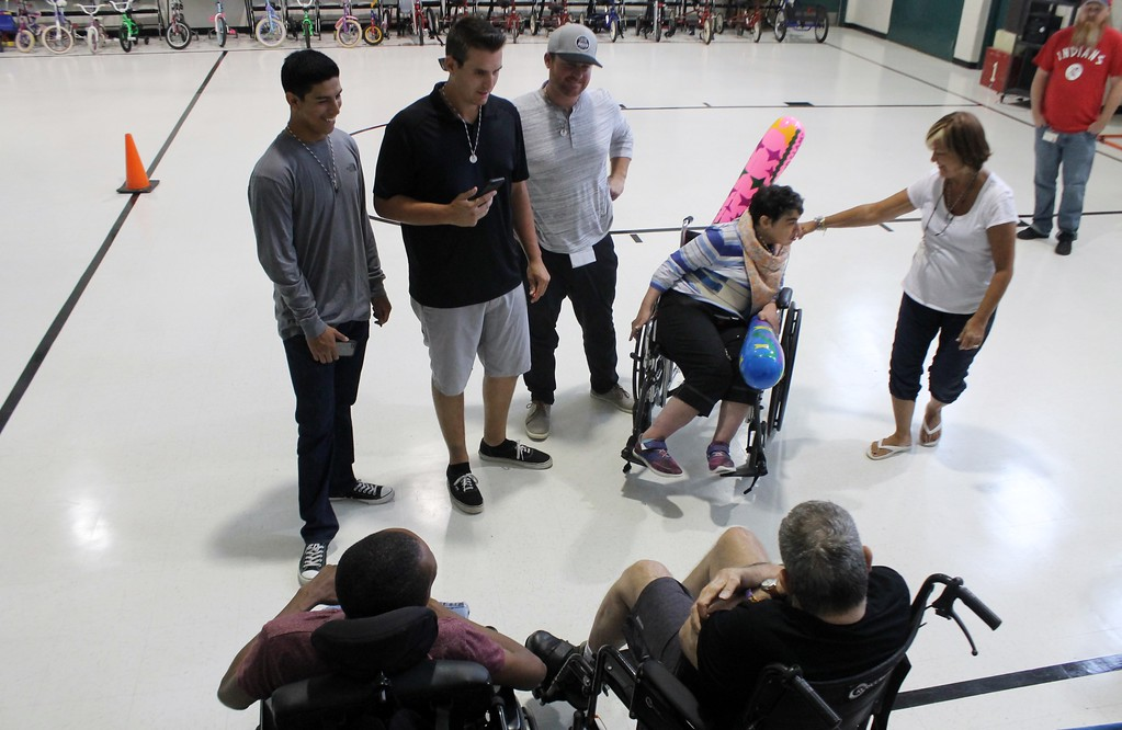 . Kristi Garabrandt � The News-Herald <br> Lake County Captains pitchers Justin Garza and Brady Aiken along with manager Larry Day interact  with clients during Captains community service day at Broadmoor.