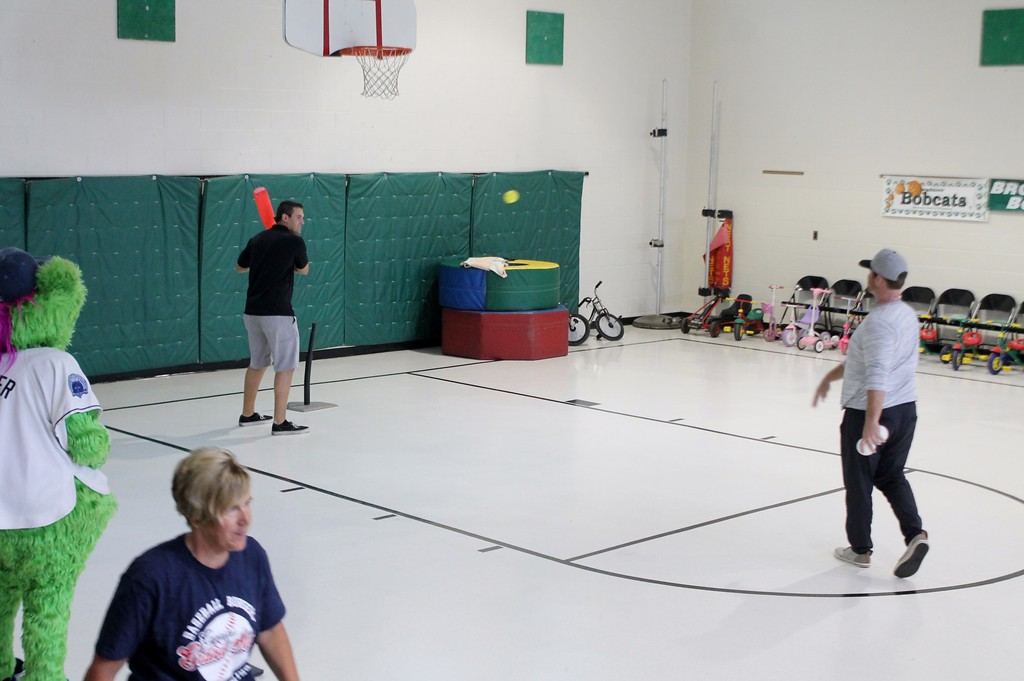 . Kristi Garabrandt � The News-Herald <br> Lake County Captains manager Larry Day throws a few pitches to pitcher Brady Aiken while waiting for everyone to gather for baseball during the Captains community service day at Broadmoor.