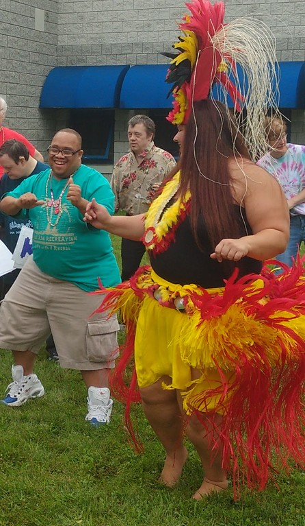 . Submitted art  Employees of Deepwood\'s Willoughby Branch dance with Roseann Riggins and  of Hula Fusion at annual luau.