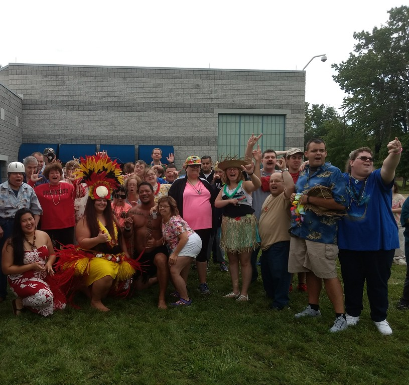 . Submitted art  Employees of Deepwood\'s  Willoughby Branch pose Roseann Riggins and Tessa Heung of Hula Fusion and Firenesia Ku\'u Awai  at annual luau.