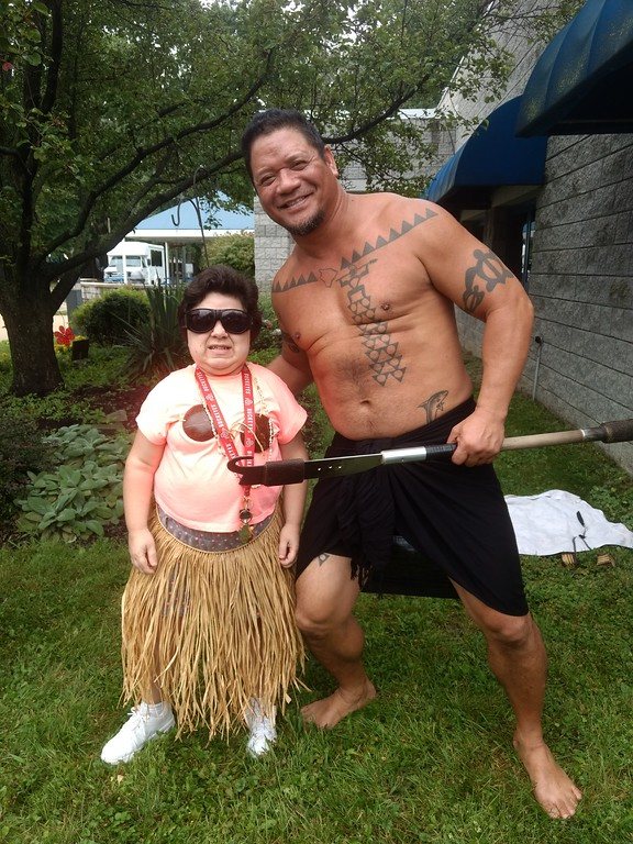. Submitted art  Employee Courtney Collins of Deepwood\'s  Willoughby Branch poses with Firenesia dancer Ku\'u Awai  at annual luau.