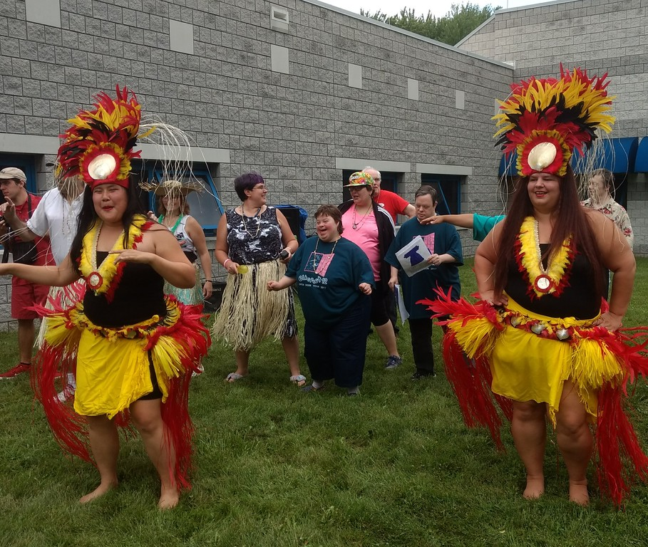 . Submitted art  Employees of Deepwood\'s Willoughby Branch dance with Roseann Riggins and Tessa Heung of Hula Fusion at annual luau.