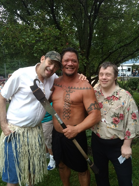 . Submitted art  Employees of Deepwood\'s  Willoughby Branch poses with Firenesia Ku\'u Awai  at annual luau.