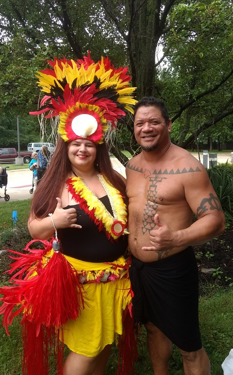 . Submitted Art    Roseann Riggins  of Hula Fusion and firenesia dancer Ku\'u perform at Deepwood\' s Willoughby Branch\'s  annual luau.
