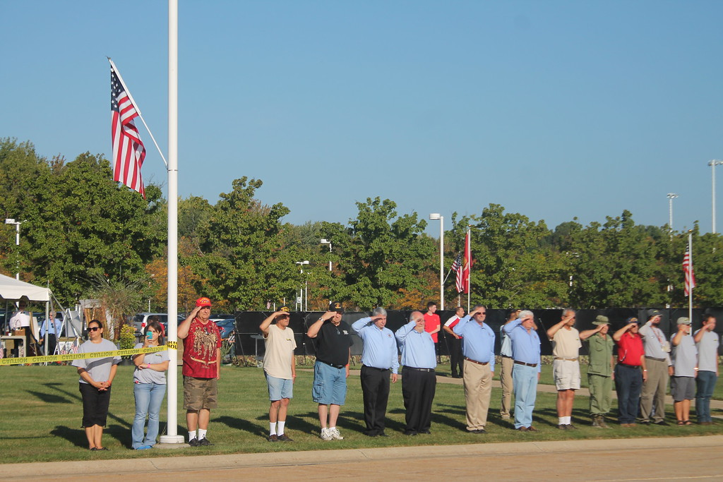 . Kristi Garabrandt � The News-Herald <br> Veterans salute the Panels of the Moving Wall, a half scale replica of the Vietnam Memorial in Washington D.C when it arrived at Perry High School on Sept. 21.