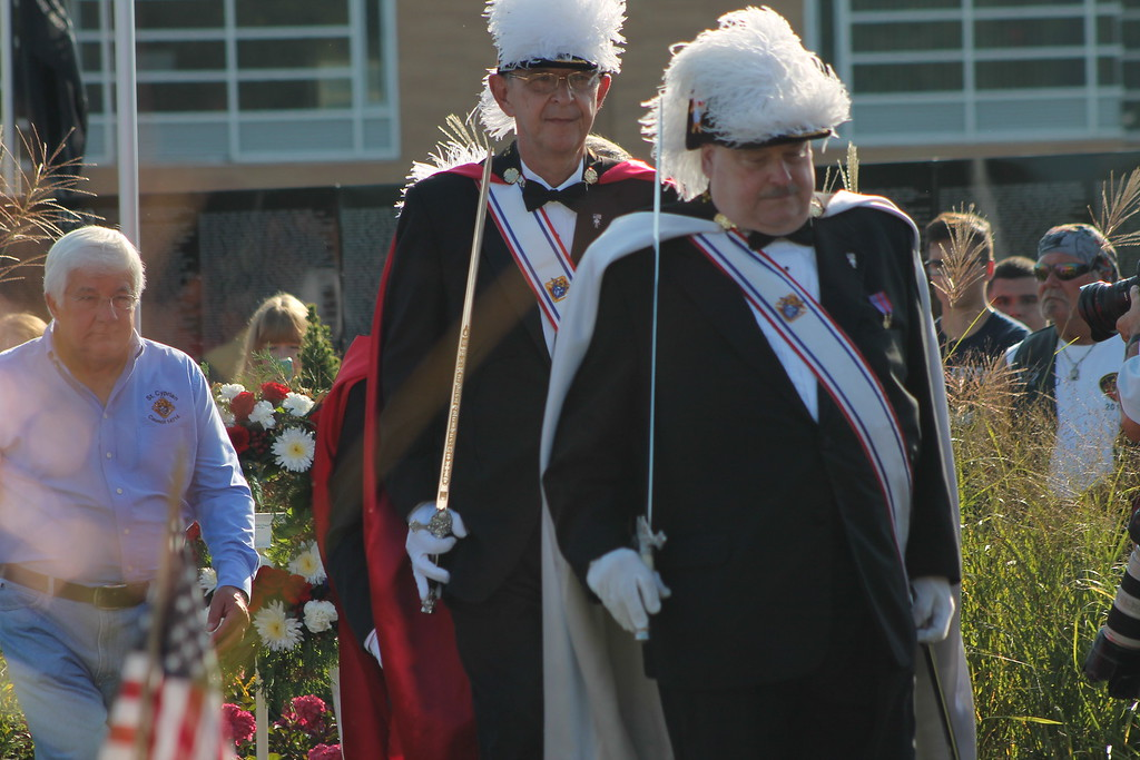 . Kristi Garabrandt � The News-Herald <br> Knights of Columbus, Council 14714 of St. Cyprian retreat after a wreath presentation at the Moving Wall at Perry High School, Sept. 21.