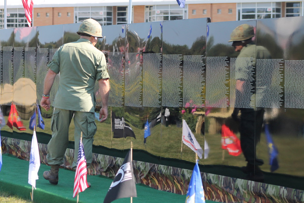 . Kristi Garabrandt � The News-Herald <br> Vietnam Veteran John Blechschmid looks for names on the Moving Wall of people he served with in Vietnam. Sept. 21.