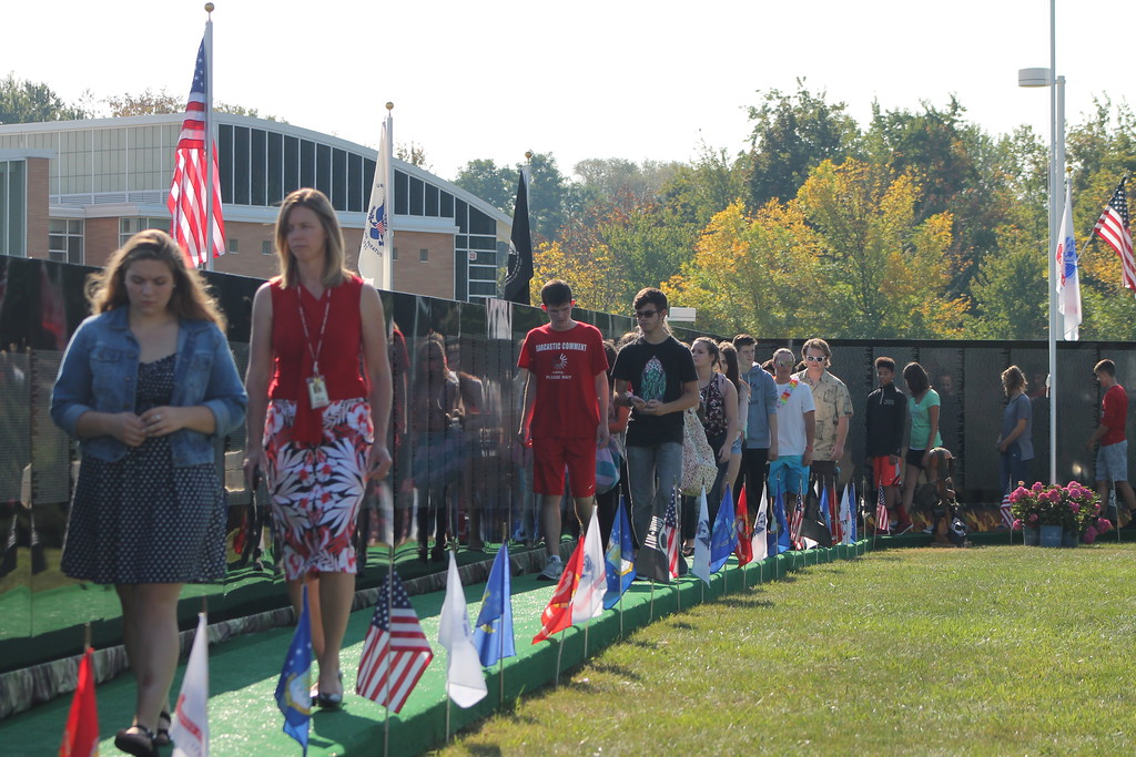 . Kristi Garabrandt � The News-Herald <br> Staff and Students from Perry High School walk along The Moving Wall after it\'s assembled, Sept. 21.