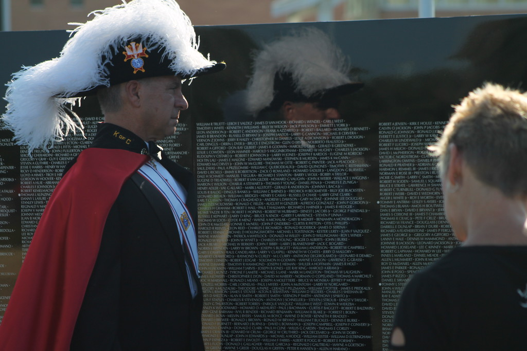 . Kristi Garabrandt � The News-Herald <br> Knights of Columbus, Council 14714 of St. Cyprian member, Frank Whalen  looks at the wall after his council presented a wreath at Perry High School, Sept. 21.