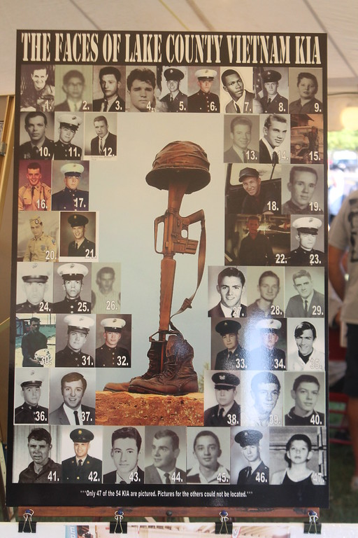 . Kristi Garabrandt � The News-Herald <br> A picture showing many of the faces of those from Lake  County who lost their lives serving in Vietnam on display at The Moving Wall at Perry High School. Sept. 21.